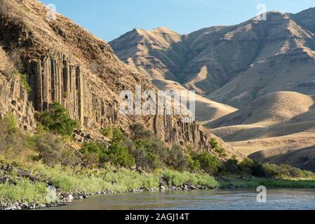 Columnar basalt formation along Idaho's Lower Salmon River. - Stock Photo