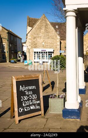 Not your normal tea shop. Sign outside the Methuen Arms hotel in Corsham Wiltshire England UK - Stock Photo