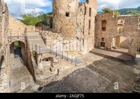 The interior of the ancient ruins of Doria castle or castrum, built in the 12th century on a mountaintop in the Ligurian village of Dolceacqua, Italy - Stock Photo