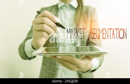 Word writing text Market Segmentation. Business photo showcasing dividing a market of potential customers into groups Business woman pointing in empty - Stock Photo