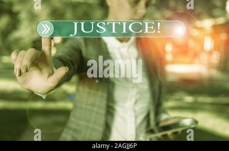 Handwriting text writing Justice. Conceptual photo impartial adjustment of conflicting claims or assignments Business woman in the nature pointing wit - Stock Photo
