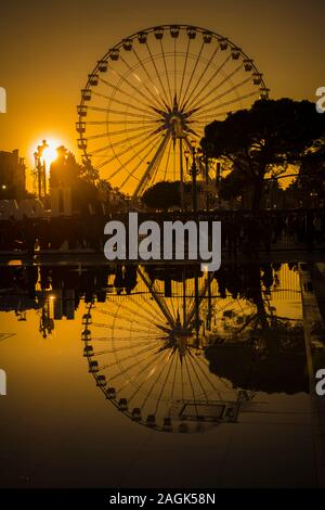 Ferris wheel In Dusk In Nice, Provence-Alpes-Côte d'Azur, France. - Stock Photo