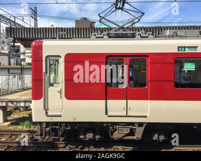 Osaka, Japan - Apr 12, 2019. A local train stopping at the JR station in Osaka, Japan. Trains are a very convenient way for visitors to travel around - Stock Photo