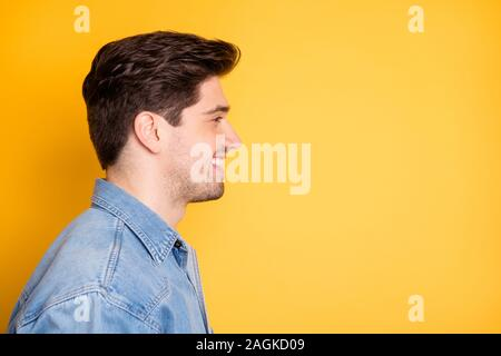 Side profile close up photo of cheerful toothy positive man dreaming comtemplating empty space in front of him isolated vivid color background - Stock Photo