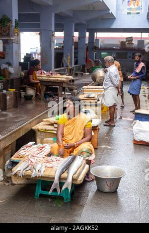 Woman selling fish in Goubert Market, Puducherry, Tamil Nadu, India - Stock Photo
