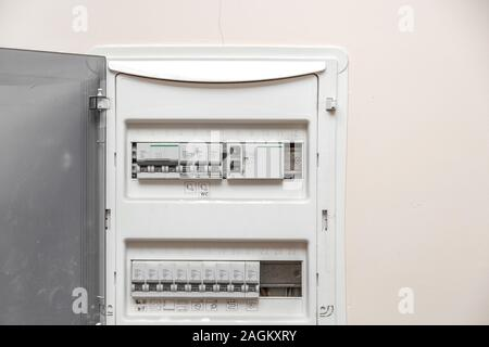 Electricity distribution box. Fusebox. Isolated on apartment wall - Stock Photo