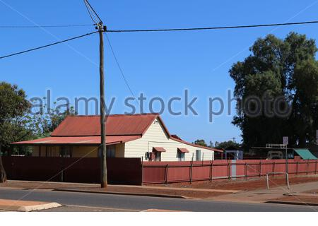 Detached residential house with corrugated sheet iron roof and fence in Western Australia - Stock Photo
