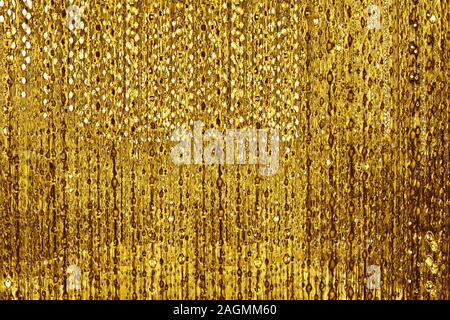 Abstract shiny golden lines and bubbles backdrop, blurred bokeh background, glowing gold colored decorative stripes pattern, yellow metallic texture - Stock Photo