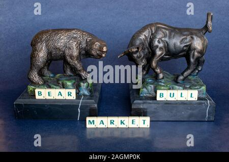 Bear and Bull markets represented by the Bull and the Bear are financial markets driven by investor sentiment both optimistic and pessimistic. - Stock Photo