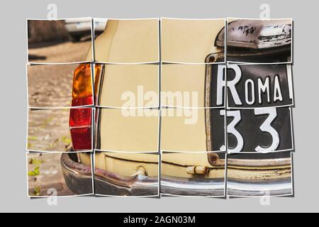 Partial view of the back of a old Fiat Nuova 500 (built from 1957-1977) with a black number plate in the streets of Rome, Lazio, Italy, Europe - Stock Photo