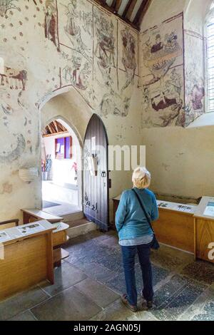 Medieval wall paintings discovered during a renovation inside the parish church of St Cadoc in Llancarfan, Vale of Glamorgan, Wales, UK - Stock Photo