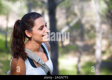 Smiling woman portrait side view. Young caucasian Spanish girl against agriculture fields. Freedom in nature. - Stock Photo