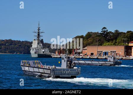 Sydney, NSW, Australia - October 31, 2017: HMAS Hobart in Wooloomooloo wharf and exercise with landing crafts of the Royal Australian navy - Stock Photo