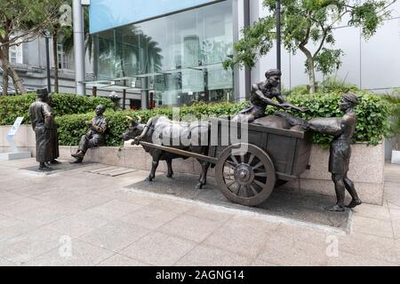 Bronze statues of The River Merchants on the River Sing in Singapore - Stock Photo