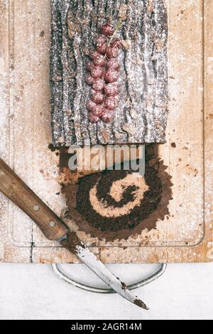 Homemade Christmas chocolate yule log - Stock Photo