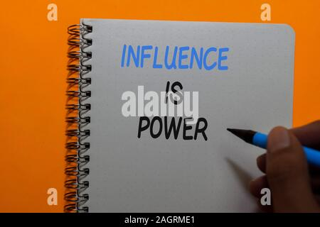 Influence Is Power write on sticky notes isolated on Office Desk - Stock Photo