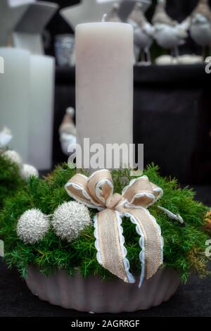 Colorful christmas decoration with pine cones and candles, festive