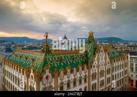 Amazing roof in Budapest, Hungary. State Treasury building with Hungarian Parliament in winter time.  All tiles on the roof made from the world famous