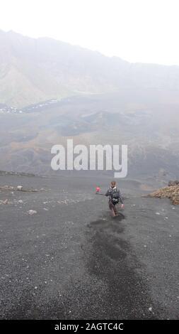 Some hikers descending the Pico de Fogo volcano on Fogo Island in Cape Verde - Stock Photo