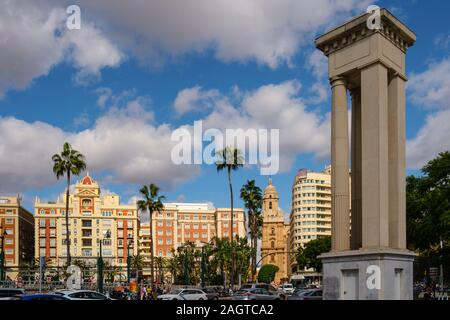 Entrance columns to the port and general view with cathedral and Plaza de la Marina, Málaga capital, Costa del Sol, Andalusia south of Spain. Europe - Stock Photo