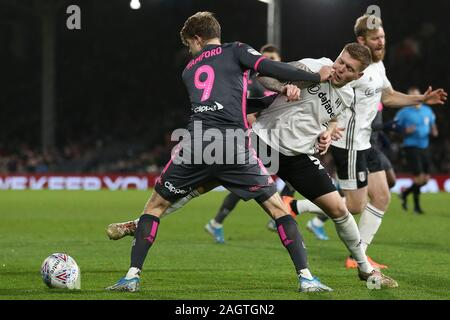 LONDON, ENGLAND - DECEMBER 21ST Alfie Mawson of Fulham tackling Patrick Bamford of Leeds United during the Sky Bet Championship match between Fulham and Leeds United at Craven Cottage, London on Saturday 21st December 2019. (Credit: Jacques Feeney | MI News ) Photograph may only be used for newspaper and/or magazine editorial purposes, license required for commercial use Credit: MI News & Sport /Alamy Live News - Stock Photo