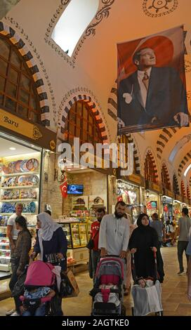 Istanbul, Turkey - September 6th 2019. Tourists walk past shops selling souvenirs in the historic Egyptian Spice Bazaar in Eminonu, Fatih, Istanbul, a - Stock Photo