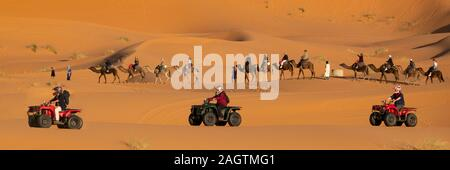 07-2019, camel or Quad, you have your choice to explore the dunes of Merzouga in southern Morocco - Stock Photo