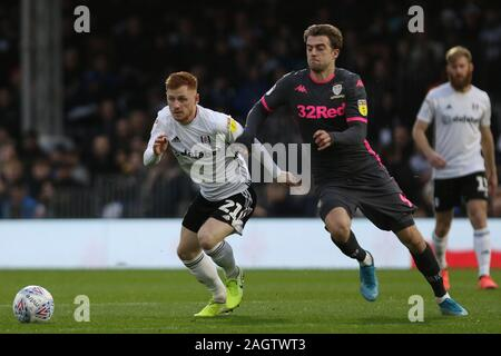 London, UK. 21 December 2019.  Harrison Reed of Fulham getting pressed by Patrick Bamford of Leeds United during the Sky Bet Championship match between Fulham and Leeds United at Craven Cottage, London on Saturday 21st December 2019. (Credit: Jacques Feeney | MI News ) Photograph may only be used for newspaper and/or magazine editorial purposes, license required for commercial use Credit: MI News & Sport /Alamy Live News - Stock Photo