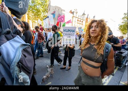 LONDON - SEPTEMBER 20, 2019: Female hippie protester at an Extinction Rebellion march - Stock Photo