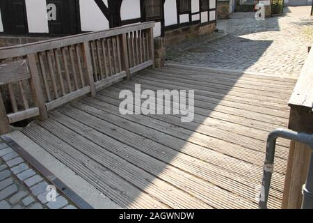 an old crooked wooden bridge