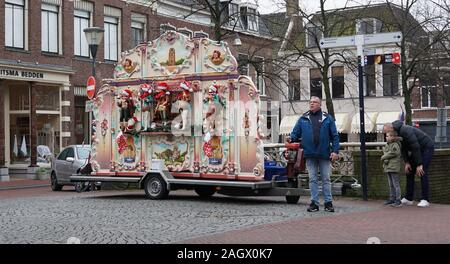 A traditional barrel organ in a street in the Netherlands. - Stock Photo