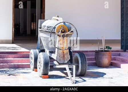 Old cement mixer at  Wat Preah Prom Rath Pagoda, Siem Reap, Cambodia - Stock Photo