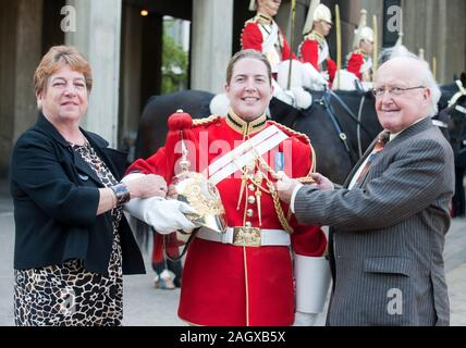 Warrant Officer 1st Class Esther becomes the first female Bandmaster in the Life guards Household division of the British Army. She attended her 'passing out' parade at the Knightsbridge barracks in London, accompanied by her parents Elaine and Tom Freeborn and Sports minister and former Lifeguard officer Hugh Robertson. - Stock Photo