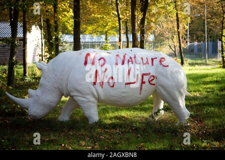 Statue off a white rhino or rhinoceros in the woodland - Stock Photo