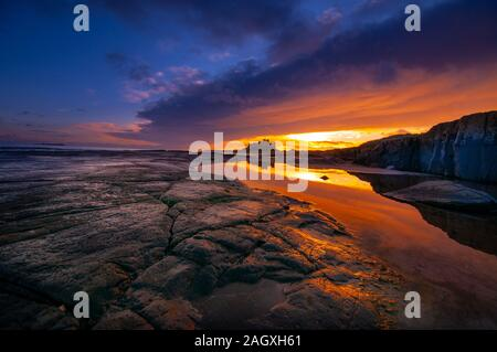 Bamburgh Castle, sunrise over this iconic English castle on the north east coast once the ancient capital of Northumbria