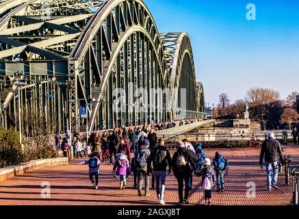 COLOGNE, GERMANY-DECEMBER 13, 2018: Hohenzollern railway and pedestrian Bridge in Cologne- By foot and by train across Rhine River. - Stock Photo