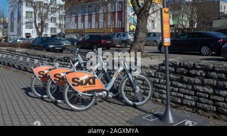20 April 2019 Tallinn, Estonia. Parking city bikes on one of the streets of the city. - Stock Photo