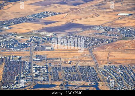 Daybreak Lake and Community and Oquirrh Mountains aerial, Copper Mine, Wasatch Front Rocky Mountains from airplane during fall. South Jordan and Herri - Stock Photo