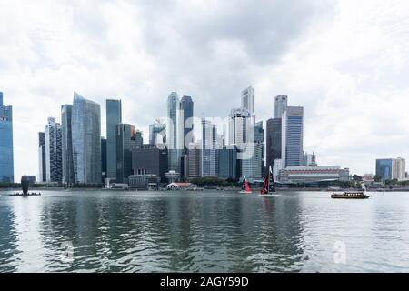 Singapore business skyscrapers viewed from The Marina Bay Sands Hotel and Shopping Mall - Stock Photo