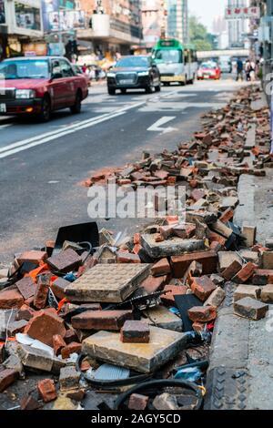 HongKong - November, 2019: Brick stones on street, cleared road barricades, during the 2019 HongKong protests, a series of demonstrations in Hongkong - Stock Photo