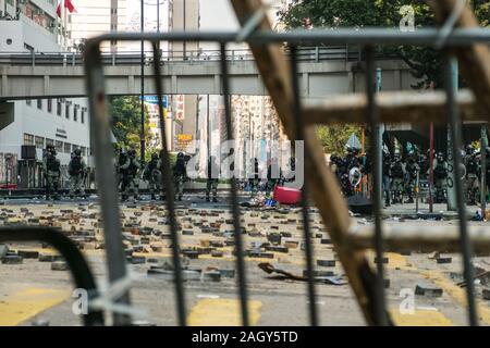 HongKong - November, 2019:  Police on blocked road / street barricade during the 2019 HongKong protests, a series of demonstrations in Hongkong - Stock Photo