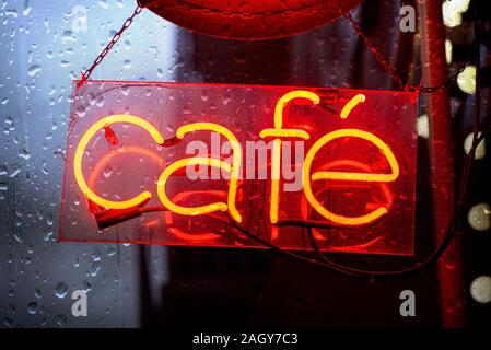CAFE neon red Sign during heavy raining Night, electronic Sign for Cafe - Stock Photo