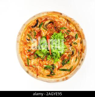 Italian cuisine and food delivery concept. Pizza with sausages, mushrooms and green onions isolated on white background. Spicy pizza with salad in middle. Take away food with crunchy edges - Stock Photo
