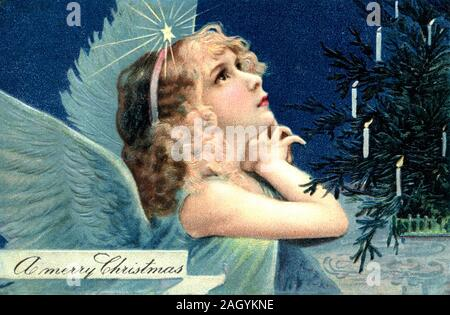 Vintage Postcard, Antique Greeting card, angelic little girl with angel wings, candles on a pine tree, light on her head, looking up - Stock Photo