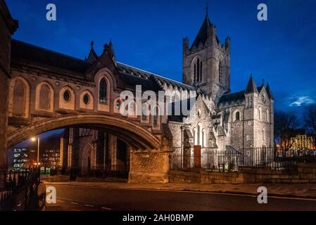 DUBLIN, IRELAND, DECEMBER 21, 2018: Christ Church Cathedral and bridge to former Synod Hall after sunset while moon is rising. - Stock Photo