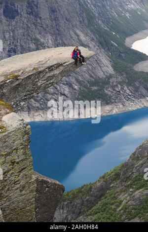 TROLLTUNGA, NORWAY - JULY 16, 2015: People visit Troll's Tongue (Trolltunga) rock in Hordaland county, Norway. The 22km trail to Trolltunga is among m Stock Photo