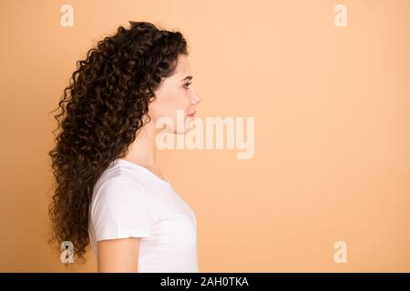 Profile photo of pretty lady seriously looking empty space not smiling corporate seminar wear white casual clothes isolated beige pastel color - Stock Photo