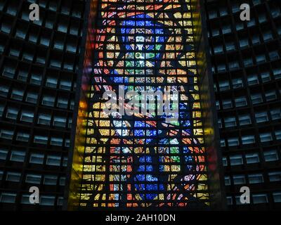 RIO DE JANEIRO, BRAZIL - 10 JULY 2014: Interior detail of the new cathedral in Rio de Janeiro with its brutalist concrete structure decorated by brigh - Stock Photo