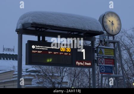 Vitebsky railway station,Saint Petersburg,Russia - January 24, 2019: Luminous scoreboard platform number 1 with the schedule of trains in Russian and - Stock Photo