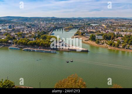 Great aerial view of the headland 'Deutsches Eck' (German Corner) between the Rhine and Mosel rivers, with the Koblenz cableway and passenger ships... - Stock Photo